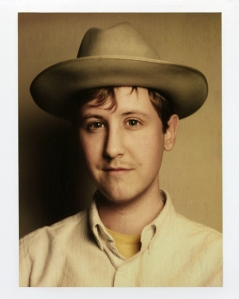 A picture of Johnny Pemberton in a hat