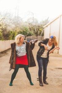 Amber Bixby and Katie Pengra outside